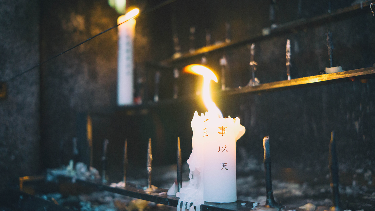 Candles were set just outside the entrance to Mt. Inari.